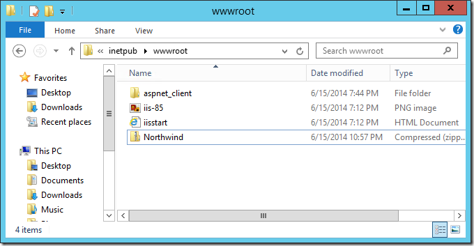 Pasting the zipped web app into the inetpub/wwwroot folder.